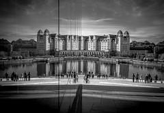 Opera House in Oslo (iz.e) Tags: glass mirror oslo norway blackandwhite reflection water skyline monochrome city sky building