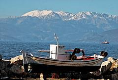 Spring is coming in Corinthian Bay (jimiliop) Tags: boat mountain sea telescopelenssnow mountaintop blue spring corinthia kiato greece afternoon windgenerators seaside seascape