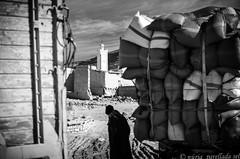 Lights of Morocco (nuriapase) Tags: imchil morocco light street blackandwhite black white blancoynegro monocrome mosque minaret tower people streetphotography travel hightatlas atlasmountains market