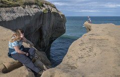 Bravely posing (Ian@NZFlickr) Tags: tunnel beach dunedin cliff pacific ocean sea danger man woman risk taking behaviour nz chris liddell was been given top role us president donald trumps white