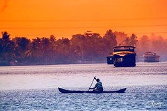 The sky takes on shades of orange during sunrise and sunset, the colour that gives you HOPE that the sun will set only to RISE again. (:::. Mänju .:::) Tags: keralagodsowncountry fishermen bestview keralatourism houseboat kuttanadu godsowncountry boatman boat sunset