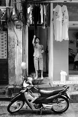 Chores no. 3 (gergelytakacs) Tags: 10 asia asian fareast hanoi hànội viet vietnam vietnamese việtnam bike bystander calle candid city cleaner cleaning clothes cycle detergent documentary door dry drying east entrance entryway flipflops flâneur hanging home house housewife housework lady laundry motorbike motorcycle photo photography pot public rue scooter shirts space strada stranger strasenfotografie street streetphotographer streetphotography streetphotgrapher streetphotgraphy streetphoto streets streetscape sun ulica unposed urban urbanphotography urbanphoto utcafotó wash washing wheels wife woman work улица רחוב