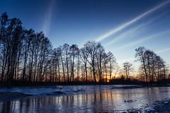 Behind the trees (kamilgalanek) Tags: sunset trees river sky