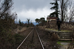 The railway goes into the distance. The guy at the broken station (ivan_volchek) Tags: tree outdoors nature landscape travel visiting wood guidance track grass road sky environment flora railway agriculture stone remote season backpack