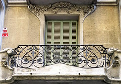 Floral window frame and wrought iron balcony, Barcelona (Spencer Means) Tags: architecture house apartment window frame molding moulding stone carved carving stonework balcony railing wrought iron modernisme modernista shutters closed dreta eixample barcelona catalonia catalunya spain dwwg
