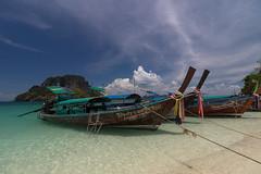 Moored longtail boats. (Gergely_Kiss) Tags: tropicalparadise thailandvacation longtailboat andamansea 4islandtour whitesandbeach thaibeaches tupisland thailand krabi