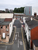 Americans'-Canadians' jaws drop when they see these bizarre two-way streets in England. (Tim Kiser) Tags: 2017 20170811 august august2017 england englishcityscape englishtownscape greatbritain greatermanchester img7415 merseyway merseywayshoppingcentre merseywayshoppingcentrecarpark merseywayshoppingcentreparkinggarage merseywayshoppingcentreparkingramp northwestengland portstreet princesstreet stockport stockportengland stockportgreatermanchester stockportcitycentre stockportcityscape stockportstreetscape uk unitedkingdom walkerstreet arrow buildings citycentre cityscape cloudy distantperson doubleyellowline drivingontheleft intersection leftsidedriving noparking noparkingareas noparkingzones northernengland northwesternengland overcast paved pavement pedestrian redlight roadmarkings roofs rooftops signalizedintersection stoplight street streetintersection streetscape townscape trafficlight twolanestreet viewfromacarpark viewfromaparkinggarage viewfromaparkingramp