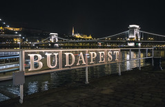 Budapest Sign (Simon Hubbert) Tags: budapest panasonic g80 g85 lumix 1260mm photography photo travel traveling travelling adventure wander backpacking journey tourist europe clouds sky hdr cloud nature landscape architecture building river sign neon lights bridge cars boats traffic road street