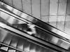 ghost (taxtamas) Tags: monochrome blackandwhite budapest hungary people blur blurry elevator lines