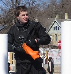 Taking off the dive gloves (chemsuiter) Tags: divegloves orangeliner diver drysuit