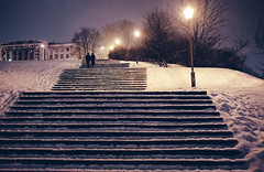 A couple walks the stairs somewhere in the city centre of Vilnius, Lithuania. (Matthias Dengler || www.snapshopped.com) Tags: vilnius lithuania winter snow couple love walking stairs staircase night evening blue hour snowing storm urban dark matthias dengler snapshopped travel nature explore discover create