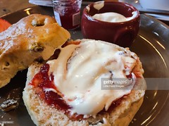 Clotted Cream Scone (Little Hand Images) Tags: clottedcream strawberryjam fruitscone potofcream plate creamtea england gettyimages