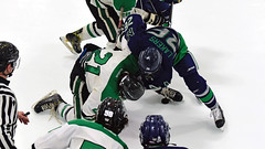 Locked up in the face-off circle (R.A. Killmer) Tags: sru ice hockey green white black acha faceoff playoff skate puck uniform slippery rock
