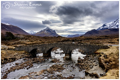 Sligachan Bridge Under Moody Clouds (Sharon Emma Photography) Tags: riversligachan old historic water river sligachanbridge bridge bridgingthegap greyskies grayskies moody gloomy cloudy rainclouds mistyisle magicalplace eternalbeauty dippingyourface isleofskye skye skai anteileansgitheanach eileanacheò skíð sunshine iconic mountains rocky loch sky clouds dramatic dramaticlandscape peninsula innerhebrides scotland scottishhebrides pictureperfect picturesque view nature naturalworld wildlife wild ngc beautiful pretty ideal stunning peaceful nikon nikond7200 d7200 sharonemmaphotography sharongoldring sharonemmagoldring sharondowphotography sharondow february2018 2018 holiday travelling