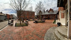 Atherton Square Panorama | Marietta, Georgia | March 18th (steveartist) Tags: athertonsquare mariettaga brickpavement trees tables chairs doorway steps traindepot alleyway alley sky clouds iphonese apexel16mmlens phototoaster stevefrenkel historicalbuildings people panorama