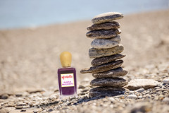 Pebbles in balancing on the beach (balhowaimil) Tags: stone equilibrium zen beach balance pile pebble stacked stack gravel concept coast meditation nature fulcrum stones rock symbol balancing group small cairn heap sea stability seascape vertical tower cobblestone