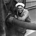 US Navy sailor fueling battleship New Mexico, c. 1919. thumbnail