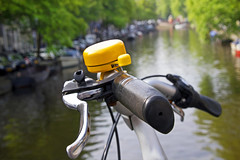ring my bell (1crzqbn) Tags: 1crzqbn bokeh bell yellow bicycle blur dof depthoffield sunlight outside canal reflections