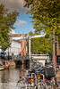 Amsterdam, Noord-Holland, Netherlands (Stewart Leiwakabessy) Tags: holland canal houses netherlands nederland noordholland grachten cars bicycles bricks bikes amsterdam canals northholland thenetherlands