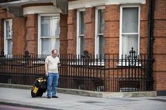 Lost in translation ----- ° (Titole) Tags: man london smartphone luggage brick facade window fence lost titole nicolefaton pavement streetscene glasses stranger tourist candid