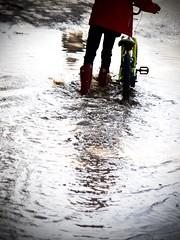 nostalgia (AriCatalán) Tags: puddle charco niño kid bicicle