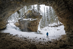The Eye of Johnston Canyon (andrewpmorse) Tags: banff banffnationalpark johnston canyon johnstoncanyon alberta winter nationalpark nationalparks naturalframe selfie cavern cave rocks rockies rockymountains snow snowing trees landscape landscapes wideangle letitsnow canon 5dmarkiv rokinon14mmf28
