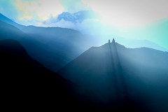 Kazbegi, Georgia (gstads) Tags: kazbegi stepantsminda georgia georgie caucasus mountain mountains mountainrange sunset shadow shadows church landscape mtskhetamtianeti gergeti gergetitrinity light sunlight sunray mist fog ngc