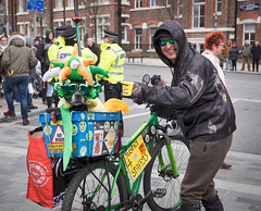 Justice 4 Staffy's. (f22photographie) Tags: parade streetparade culture paddysday stpatricksdayparade2018 colourful characters fun bikes bicycle dogs staffys green sunglasses streetphotography