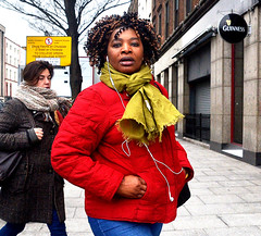 Along D'Olier Street (Owen J Fitzpatrick) Tags: ojf people photography nikon fitzpatrick owen pretty pavement chasing d3100 ireland editorial use only ojfitzpatrick eire dublin republic city tamron candid joe candidphotography candidphoto unposed natural attractive beauty beautiful woman female lady j face hair along photoshoot street 2018 st saint patricks day holiday march 17 african dark red coat eye contact earplugs visage scarf ringlets curly curl dolier parade festival stpatricksday