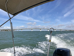 Ringling Bridge, Sarasota, Florida (soniaadammurray - On & Off) Tags: iphone sea sky clouds boating wake bridges ringlingbridge boats land trees beach nature artweekgallerygroup seascape water beauty sarasota florida usa