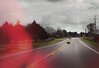 me & the devil (roadkill rabbit) Tags: road highway driving louisiana black dog storm light glare bayou country