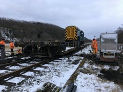 Engineers train passes the UTX site 18Mar18