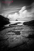 Trebarwith Strand, Cornwall (Kelly Love's Photography) Tags: t4i trebarwith gullrock canonefs1022mmf3545usm canon650d sea beachfront monochrome strand kellylovesphotography bw canoneos650d eos cornwall uk dramatic blackwhite canonrebel england gull longexposure clouds sky mono black canon6d atmosphere rocks trebarwithstrand canon1022mm beach white canon wideangle landscape moody blackandwhite seascape canonphotography canoneos canonrebelt4i