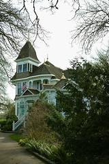 Deepwood, framed (briangeerlings) Tags: deepwoodestate deepwoodmanor salem oregon building architecture tree branches flag