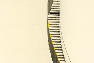 Staircase with yellow handrail