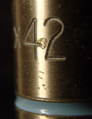 The answer (glyn_nelson) Tags: imperfections macro 36mm extensionring 42 lifetheuniverseandeverything objective microscope prior brass lens macromondays corroded
