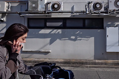 In front of my eyes I was passing by the beauty of Japanese (明遊快) Tags: woman street alley shadows bike sunlight city winter mobile japanese candid lines contrast 日本美人