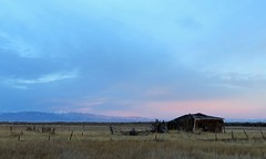 Derelict (Patricia Henschen) Tags: abandoned ruin ranch sanluisvalley countryside rural colorado alamosa clouds backroad sunrise alpenglow southriverroad mountains sanjuan sanjuanmountains
