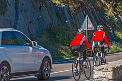 E65 Cyclists (fotofrysk) Tags: e65highway road cyclists bicycles riders red helmets car suv istriamontenegroroadtrip montenegro bayofkotor adriaticcoast dalmatiancoast afsnikkor703004556g nikond7100 201710099316