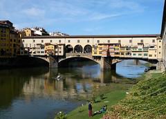 Ponte Vecchio Bridge,  Florence. (Country Girl 76) Tags: ponte vecchio bridge river arno florence italy people grass canoe shops history sky reflections