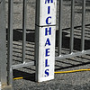 Michael's Sign On Ride Fence. (dccradio) Tags: lumberton nc northcarolina robesoncounty outside outdoors festival communityevent fun entertainment sign fence cord yellowcord michaels shadow ridefence