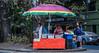 2018 - Mexico City - Condesa - Now Serving Breakfast (Ted's photos - For Me & You) Tags: 2018 cdmx cityofmexico cropped mexico mexicocity nikon nikond750 nikonfx tedmcgrath tedsphotos tedsphotosmexico vignetting food foodcart umbrella foodstand streetscene street starbucks starbuckscoffee curb