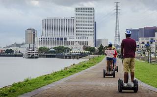 Tourists riding Segways along Riverwalk
