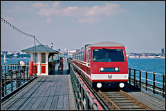 Southend Pier Railway (Jason 87030) Tags: southend essex sarfend railway red livery scan slide 1990 tracks rails weather summer uk england scene unitedkingdom greatbritain seaside publictransport movement transportation water coast resort fishing angler people holiday pleasure leisure shelter