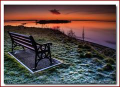 Sit Down, Sunrise Won't Be Long (Deek Wilson) Tags: sunrise ardspeninsula strangfordlough newtownards islandhill landscape seat bench northernireland lough water sky stilllife
