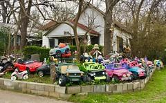 Texas Car Lot (jurvetson) Tags: sxsw austin scenes weekend car lot front yard toy