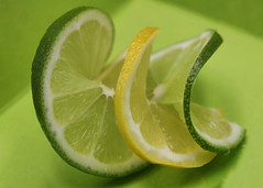 Twisted (Helen Orozco) Tags: macromondays citrus limes lemon twists fruit hmm three slices macro fuits