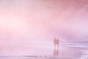 Love is pink (Mimadeo) Tags: couple person two beach sunset walking romantic romance sea coast vacation water people pink walk silhouette love sand man summer woman shore together holdinghands vintage retro instagram effect filter old vivid vibrant sky nature landscape beautiful evening highkey fog foggy mist misty dreamy fantasy