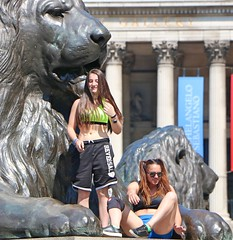 Sports Girls Reversal (Waterford_Man) Tags: girls glasses sporty shorts bare midriff midrift sportsbra london candid people tourists mobile phone