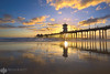 Two Skies For the Price of One (Brian Knott Photography) Tags: huntingtonbeach beach reflection sunset sunrise california huntingtonbeachpier pier clouds cloudy smooth calm clear lowtide glassy sand silhouette sun diminishing